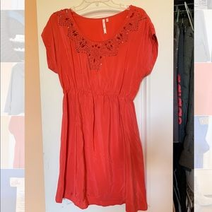 Beaded coral dress.